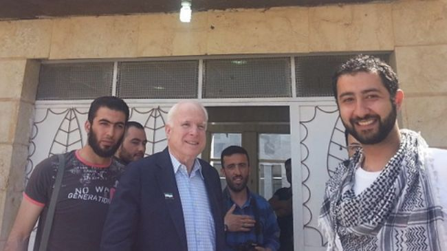 Standing to the right of John McCain, known terrorist and kidnapper Mohamed Nour, pictured in Syria earlier this year. Click to enlarge