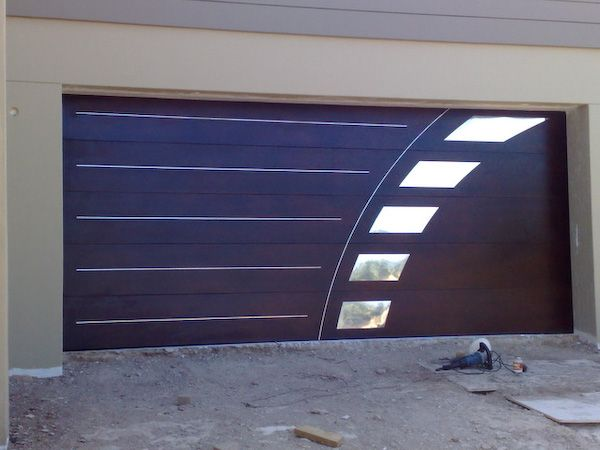 Not my cup of tea but sean 39 s a fan of this garage door for Garage doors designs