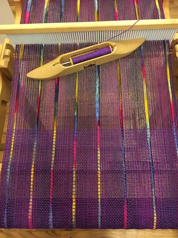 This kit includes enough yarn and ribbon plus the pattern for weaving this lovely wrap on a 15-inch or larger rigid heddle loom. Also included are instructions for an optional crochet border with button loops added. A versatile accessory, you can wear it three ways; as a scarf, button