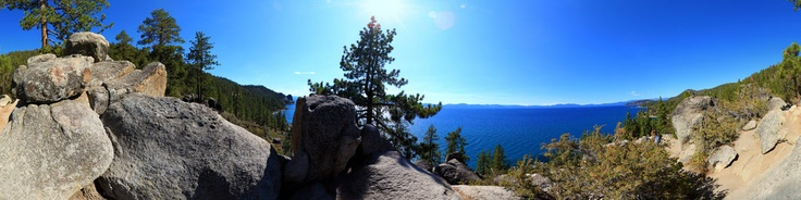 Cave Rock is on the east side of Lake Tahoe. The lake is bisected north-to-south by the California-Nevada state line. The rock hangs over the water and in the 1800s a catwalk was constructed on it's cliff face, prior to the present day highway tunnel. This panorama was shot about a mile north of Cave Rock.