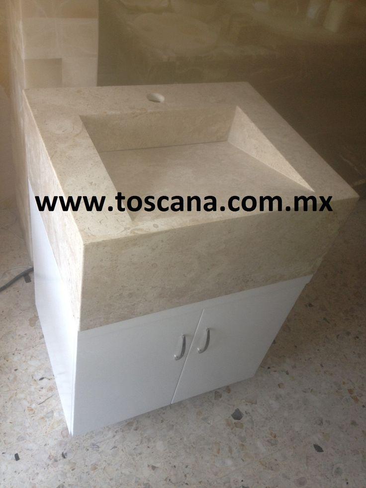 Lavabo de marmol con mueble de madera