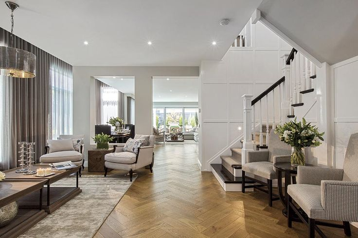 Grand hallway in the Brookwater with a Classic Hamptons World of Style.