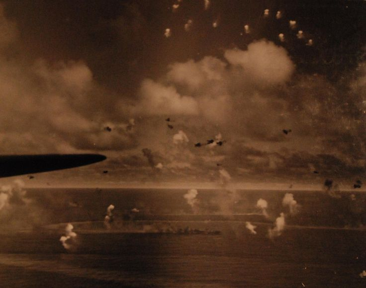 Japanese carrier burns during aerial and naval battle during Battle of Leyte Gulf. Taken by plane from USS Essex (CV 9), 25 October 1944.