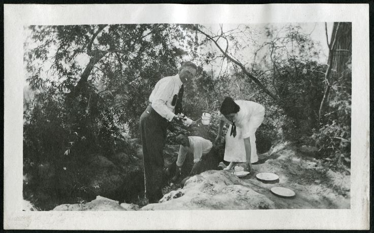 """Picnickers washing their dirty dishes in a creek located in early Las Vegas, Nevada.  Part of the UNLV Libraries """"Southern Nevada: The Boomtown Years"""" digital collection.  #UNLV"""