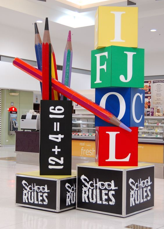 Back-to-school window display? Possibly with blocks like these but with clothes pinned to them or backpacks?: