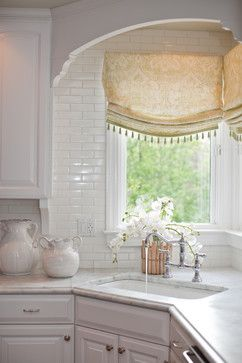 Like the shinyness of glass tile with neutrality of single color. Also like idea of danglies for my kitchen curtain.