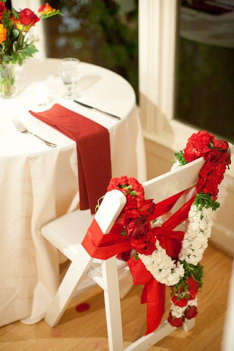 © Jason Fukura   floral chair garlands at Indian style wedding