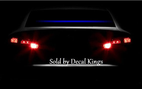 Thin Blue Line decal, Thin blue line reflective windshield sticker 65  wide X 1.5  tall cut to length, made out of quality vinyl that is blue in the daylight and reflects blue at night. Shipped insured.