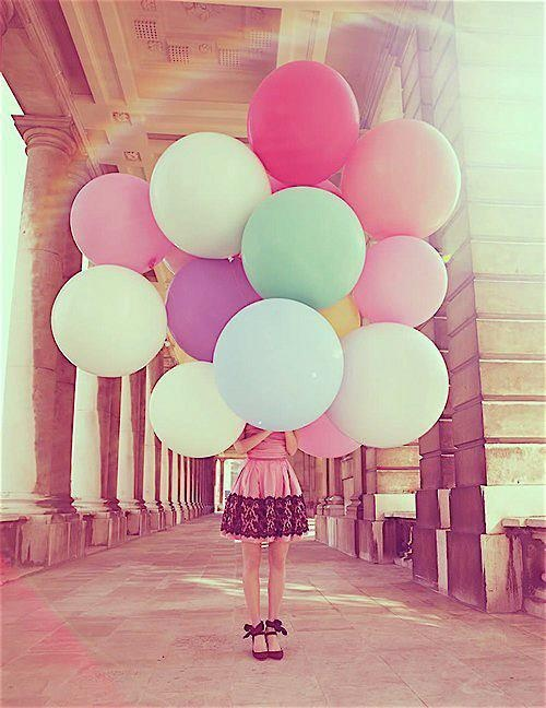 Balloons make for cheerful, colourful wedding shots.