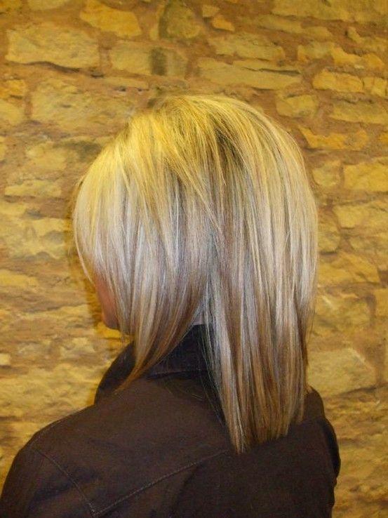 Love this cut (for a shorter/bob look with a modern flair)