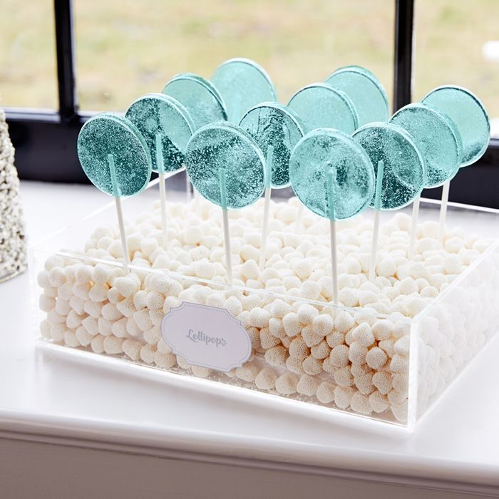 Pretty display of translucent lollipops in a bed of champagne bubbles jelly candies.