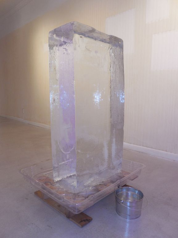 Installation: Mixed Media  Size: 40 H x 20 W x 10 in  300lbs Ice cubicle, pallet and bucket  Keywords: pallet, bucket, Ice cubicle, 300lbs, impermanence. This Too Shall Pass, Peter Hammar