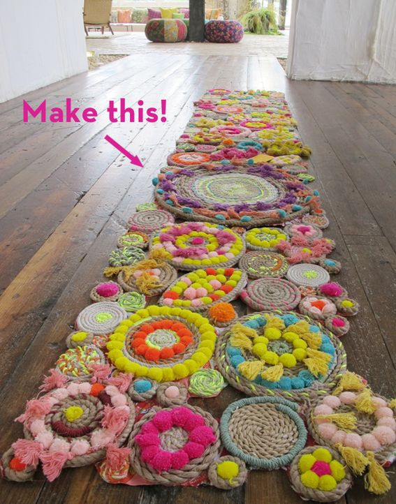 Make It: A Stunning DIY Rope Rug!  Not clear on how the pom poms attach.  Adorable.