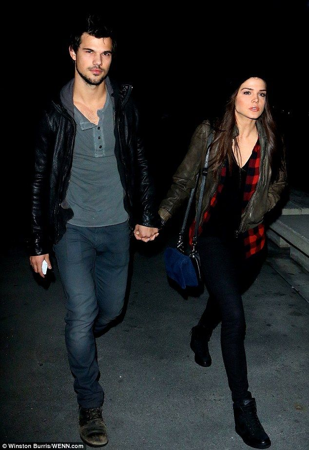 Celebrity couple Taylor Lautner and girlfriend Marie Avgeropoulos in LA. via dailymail.co.uk