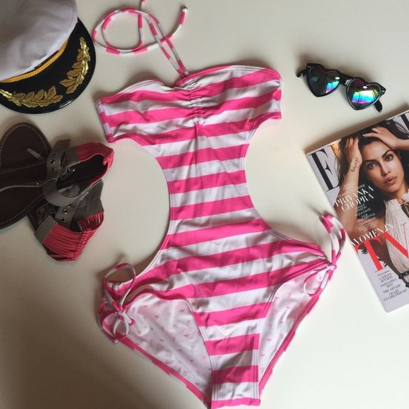 PINK One Piece Open Sides & Back Swimsuit Pre-loved (worn just a few times) PINK bathing suit. Adorable hot pink & white striped, perfect to accessorize with your sailor hat. There are a couple of raised pulls in the fabric from sitting (see last photo), barely noticeable. I love this piece because it's a statement swimsuit for sure, yet it really provides coverage to the tummy. PINK Victoria's Secret Swim One Pieces