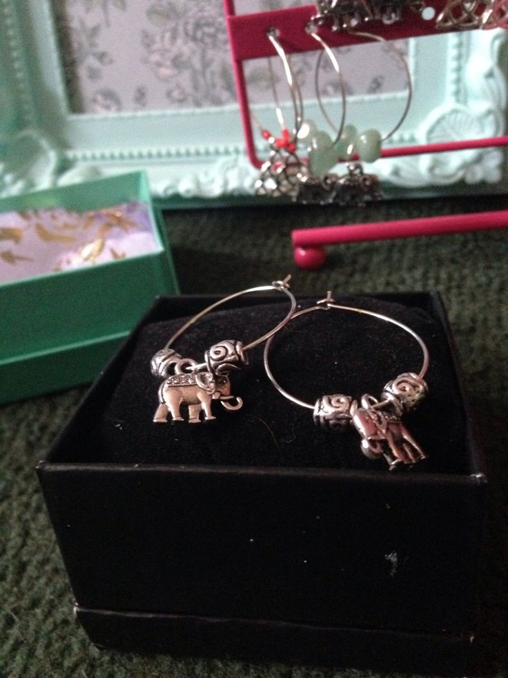 A personal favourite from my Etsy shop https://www.etsy.com/uk/listing/464482725/hoop-earrings-with-elephant-charm