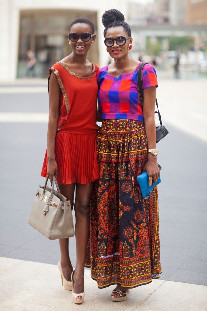 Floral/ethnic maxi or midi skirt + cropped graphic print top + animal print heels + large stud earrings