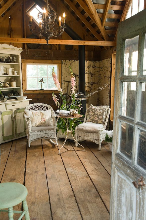 Inside the garden shed . ....♥♥... utilitarian space has been transformed into a garden hideaway complete with sitting area, woodstove, antique display cabinets for garden trinkets, a potting bench, and a work desk for recording the seasonal changes.