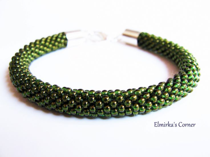 Shimmering olive green handmade bead bracelet  see more: https://www.facebook.com/ElmirkasCorner/posts/854915541282533