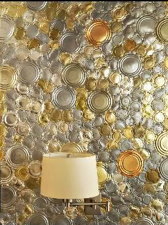 Tin can tops on wall
