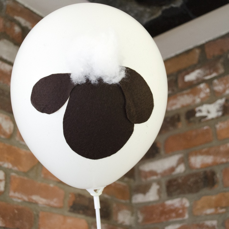 Balloon with felt cutouts to represent Shaun the Sheep (dont forget the tuft of cotton for his head)!