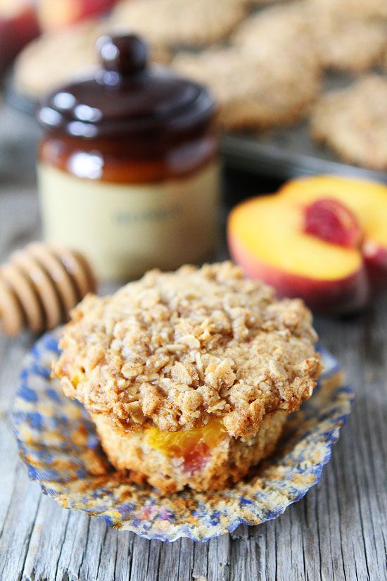 Honey Peach Muffins with Oat Streusel Topping Recipe on twopeasandtheirpod.com