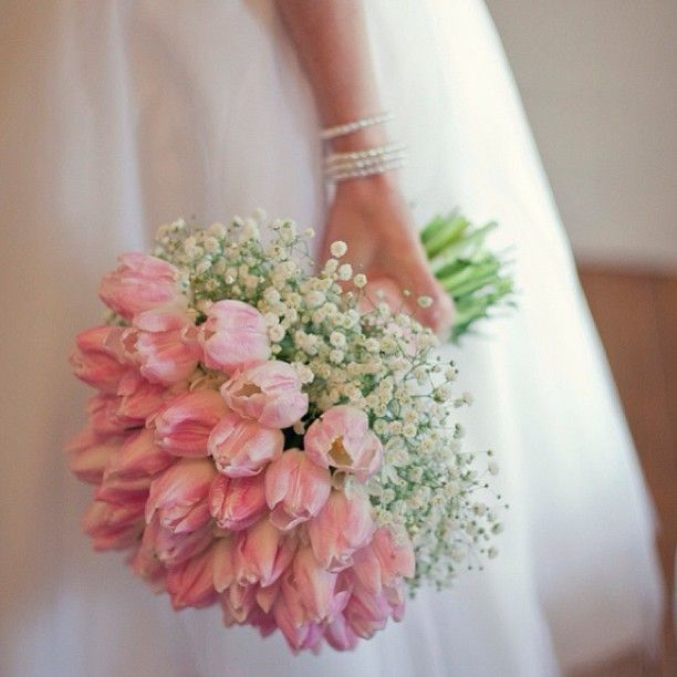 Pink tulips and baby's breath bridal bouquet                              …