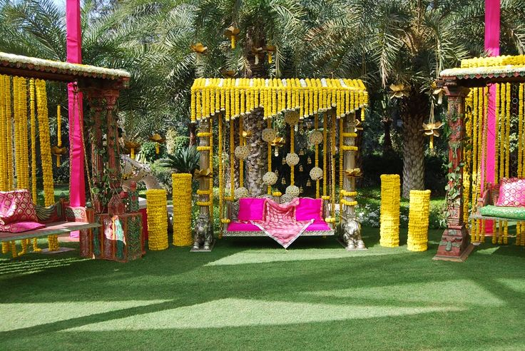 Wedding lawn decoration with traditional flowers and drapes. Ideal for family functions and celebrate the occasion with fun and frolic. #InspiredWeddingDecor #Kanpur #genda