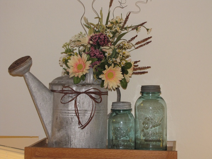 Old watering can I decorated with leftover wedding flowers