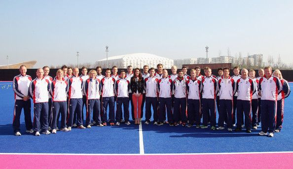 Catherine, Duchess of Cambridge poses with the GB Mens's Hockey Team at the Riverside Arena in the Olympic Park on March 15, 2012 in London, England. The Duchess of Cambridge viewed the Olympic park as well as meeting members of the men's and women's GB Hockey teams.
