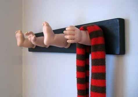 Doll parts and a piece of wood are all you need to make a hilarious (and slightly disturbing) coat rack.