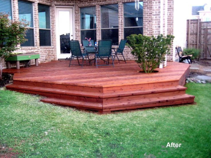 Exterior:Stunning Hexagon Deck With Stair For Outdoor Decoration With Three Level Wood Step And Brick Wall House Exterior Outstanding Deck W...