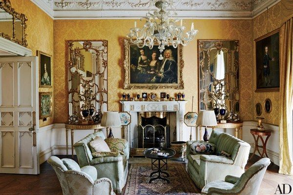 An 18th-century Venetian chandelier complements the Yellow Drawing Room's 1930s damask sofas and chairs. The marble mantel is also 18th century, as are the rococo mirrors and the gilt-wood demilune tables.