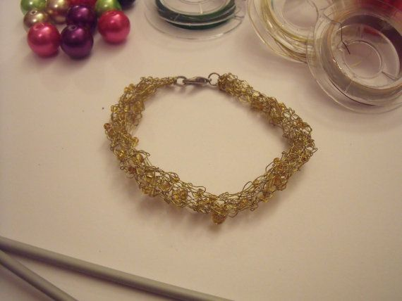 Knitted yellow wire bracelet with complementary gold seed beads
