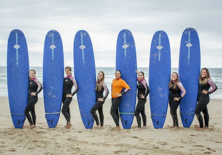 Trainees posing with surfboards