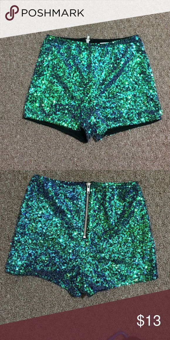 Sparkly shorts Super cute and funky sparkly blue/green shorts. Never worn Charlotte Russe Shorts