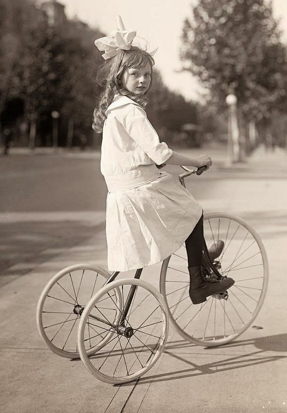 vintage everyday: Girl Riding Tricycle, ca. 1915
