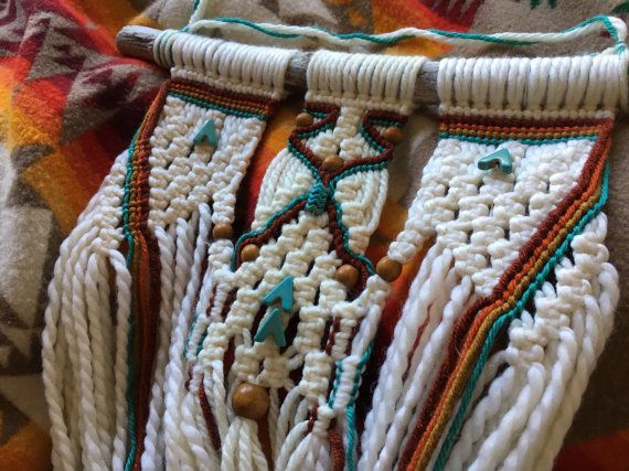 This is a one-of-a-kind, hand-knotted macramé wall hanging, made with natural-color chunky yarn as well as rust, orange, gold, and turquoise highlight yarns, knotted onto a piece of driftwood from the Sonoma Coast in California. Turquoise and wooden beads woven in throughout. A beautiful
