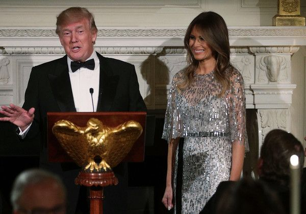 U.S. President Donald Trump speaks as first lady Melania Trump listens during a reception at the State Dining Room of the White House September 14, 2017 in Washington, DC. President Trump and the first lady hosted a reception for the White House Historical Association. - President And Mrs Trump Host White House Historical Association Dinner
