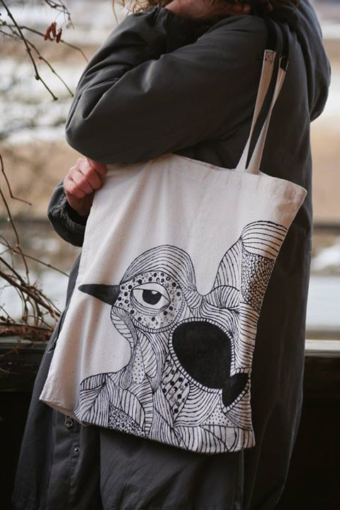 Hand-painted recycled tote bag: bird with fish.