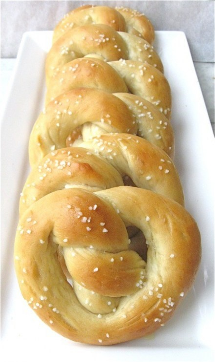 GF Soft Pretzels  3 eggs(at room temp), divided use  1-1/2 cups Gluten Free Blanched Almond Meal Flour(I use Bobs Red Mill)  1/2 tsp. salt  1 T. butter (I use GHEE)  2-3 T. Gluten Free Organic Coconut Flour(I use Bobs Red Mill)  1 teaspoon water  Coarse salt  Beat 2 eggs, and set them aside.  Add the almond flour, salt and butter together and mix well.  Into this mixture, pour and mix the beaten eggs.  This is where you should have a very wet dough.  Add in one tablespoon of coconut flour…