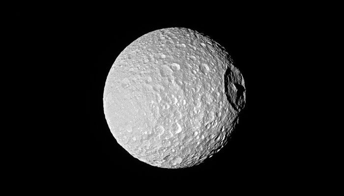 Saturn's moon Mimas Mount Everest stands tall in Cassini's latest image! NASA shared another stunning photo of Mimas, showing its defining feature – Herschel Crater – shrouded in shadows.Shadows, provide an indication of the size of the crater's & central peak. Herschel's peak is nearly as tall as Mount Everest