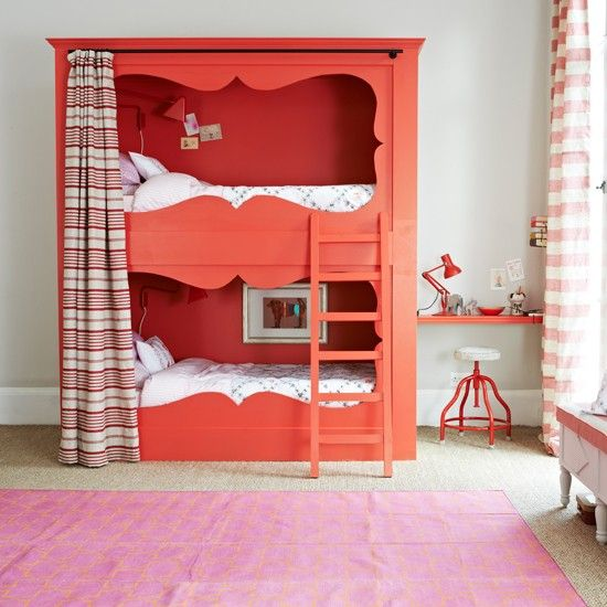 A decorative wooden frame and back panel add instant charm to a basic box bunk. Painted dashing red, which is echoed by various accessories, it makes for an eye-catching statement.