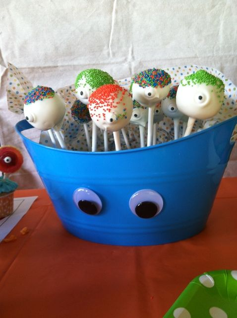 Cake pops at a Monster Party #monster #cakepops. Adopt a monster, Dollie store buckets with eyesl, watermelon monster food. Some food visual idea.