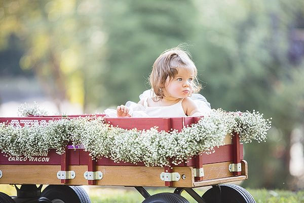 flower girl in a little red wagon! | Melissa Schollaert #wedding