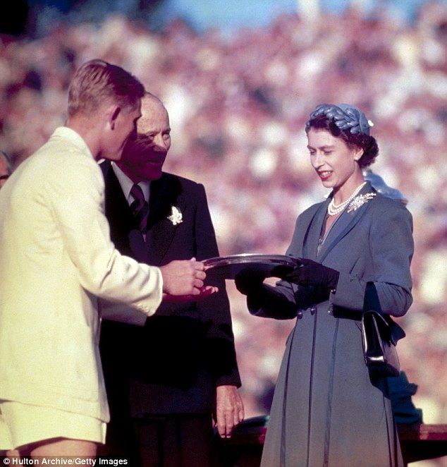 1954: Presenting the Silver Salver to Australian tennis champion Lewis Hoad at Centre Court, Kooyong, during her trip to Australia.