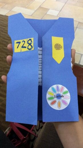 Investiture/rededication ceremony invitation.  Construction paper cut to look like my daisies vests. Used round labels with printed daisy and girl scout's name. Inside are the details of the ceremony. Very proud of these!