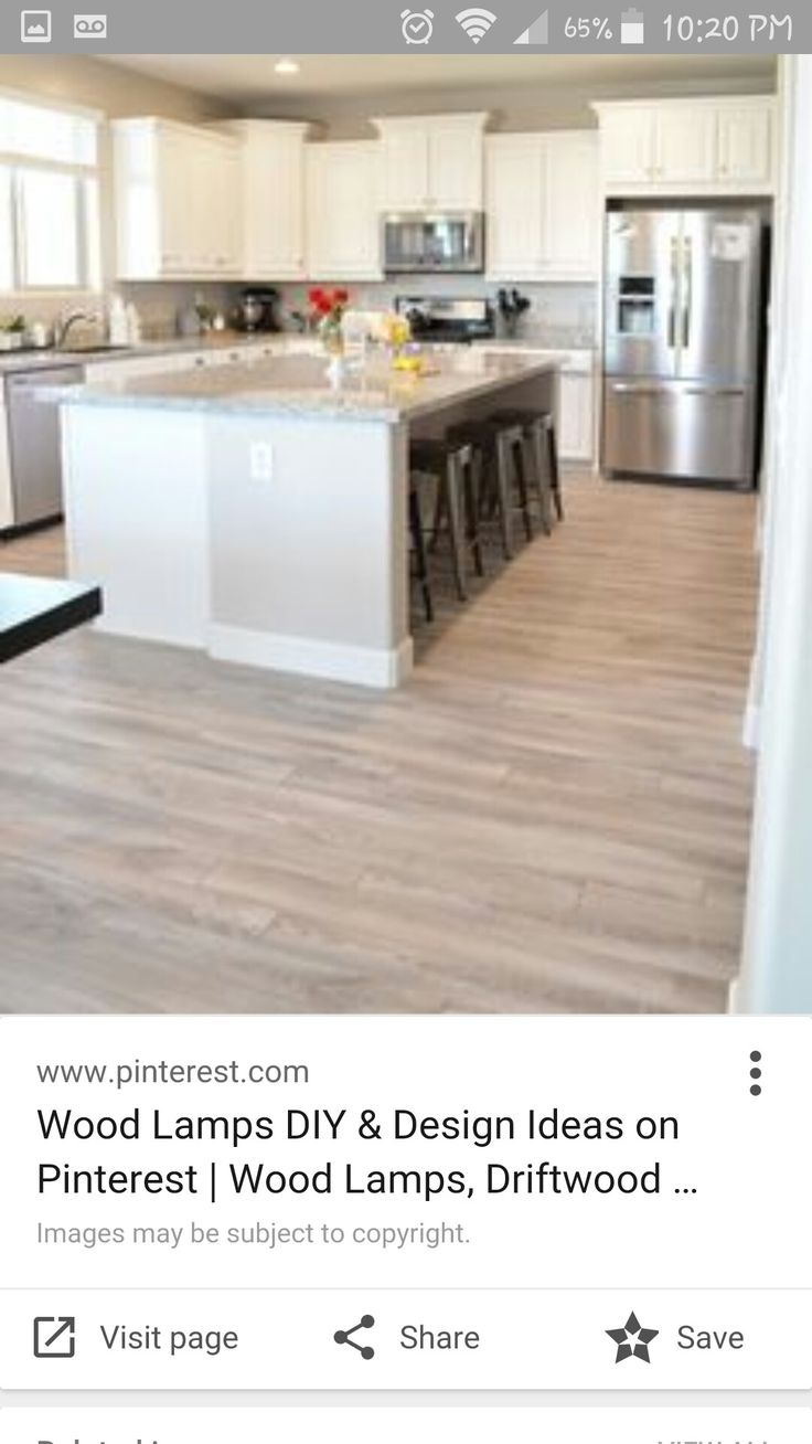 Gray tones mixed with light creams and tans suggest a floor worn ...