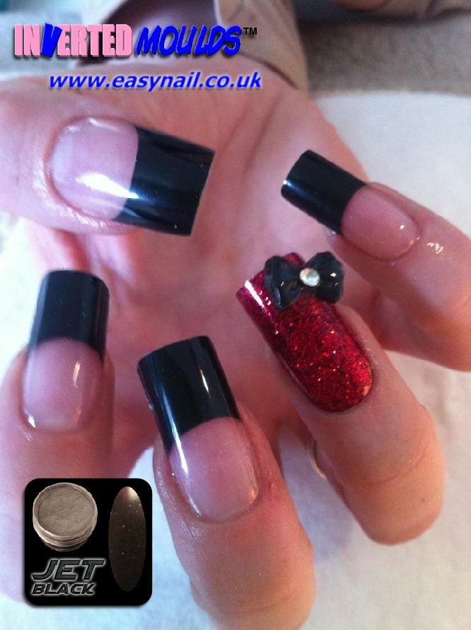 A superb set of IM's (Inverted Moulds) created by Glenda Hough for her client Leanne Hayward.    Using our JET BLACK acrylic nail art powder along with our RUBY RED nano glitter.  Along with a rather nice 3D bow attached to the ring finger using acrylic (not glue).    As you can see IM's give a perfectly smooth glossy finish every time with NO need for any buffing or topcoats!  Powders available from:    www.thenailartist.co.uk    Find us on Facebook…