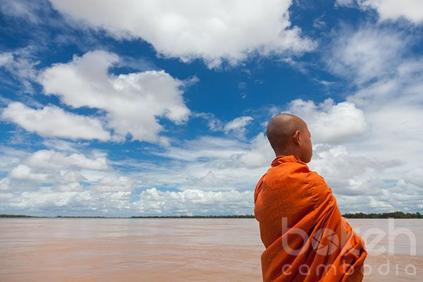 Novice monk looking out on the Mekong river | Stung Treng Province, Cambodia